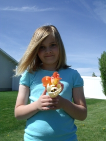 Yvonne's youngest granddaughter, with decapitated tulips from our yard.